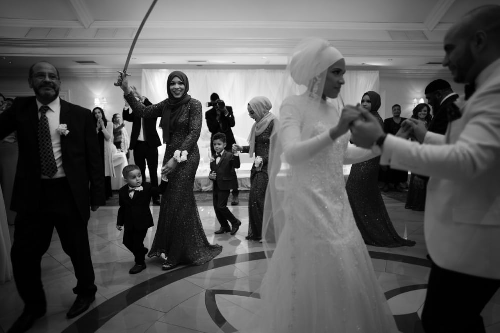 Faizah Muhammad, the younger sister of Ibtihaj, herself a highly ranked fencer, celebrated her marriage to Adam TK this evening with family and friends. Ibtihaj was a doting older sister constantly fixing Faizah's veil, fussing over her dress and keeping her hijab from slipping. The evening was punctuated with traditional dancing with swords and selfies galore. During the entire evenings festivities both women were very modest, almost shy in their behavior.
