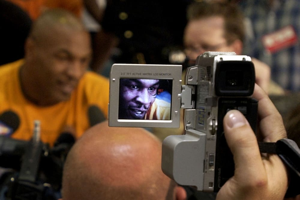 Former heavyweight champion Mike Tyson is seen in a small video camera display as he gives interviews after the final news conference for his fight against Danny Williams in Louisville, Ky., Wednesday 28, 2004. Tyson will face Williams in a scheduled 10 round bout at Freedon Hall in Louisville Friday, July 30, 2004. (AP Photo/Charles Rex Arbogast)