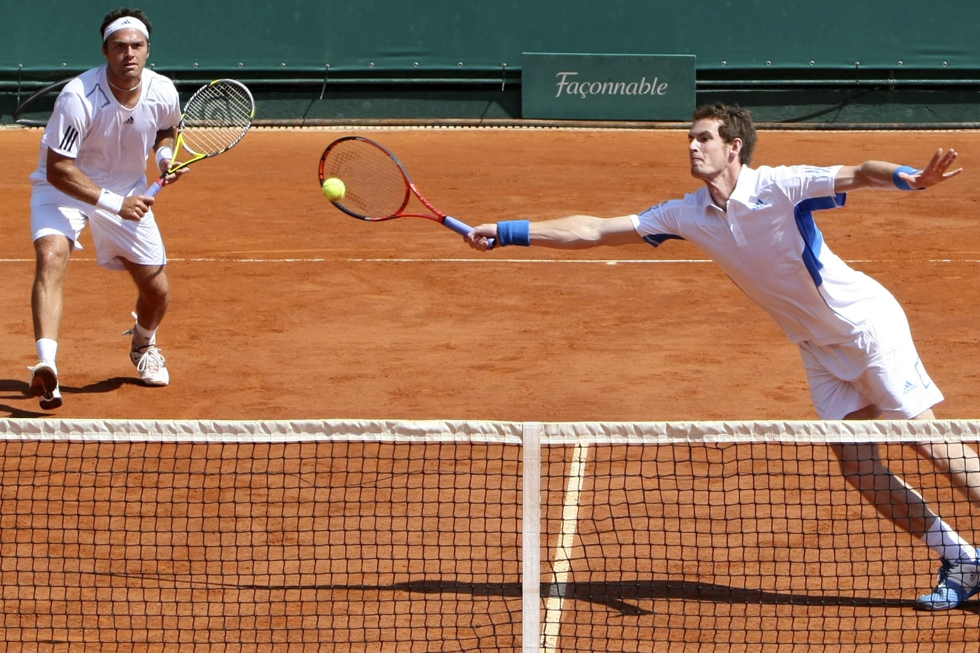 Britain's Ross Hutchins, left, looks on as doubles partner Andy Murray, right, returns the ball to USA's Mike Bryan and Bob Bryan, not seen, during their third round doubles match of the Monte Carlo Tennis Masters tournament, in Monaco, Thursday, April 15, 2010. (AP Photo/Claude Paris)