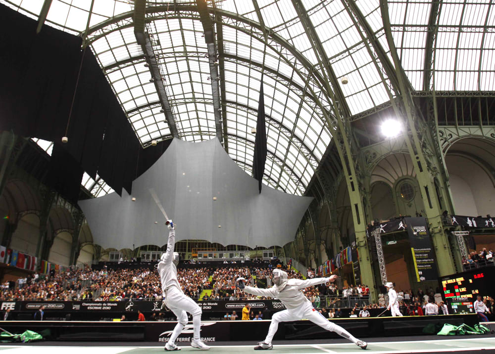 Daryl Homer of U.S., left, competes with France's Nicolas Lopez during the men's single sabre group of 16 at the fencing World Championships in the Grand Palais museum Paris, Saturday Nov. 6, 2010. (AP Photo/Christophe Ena)