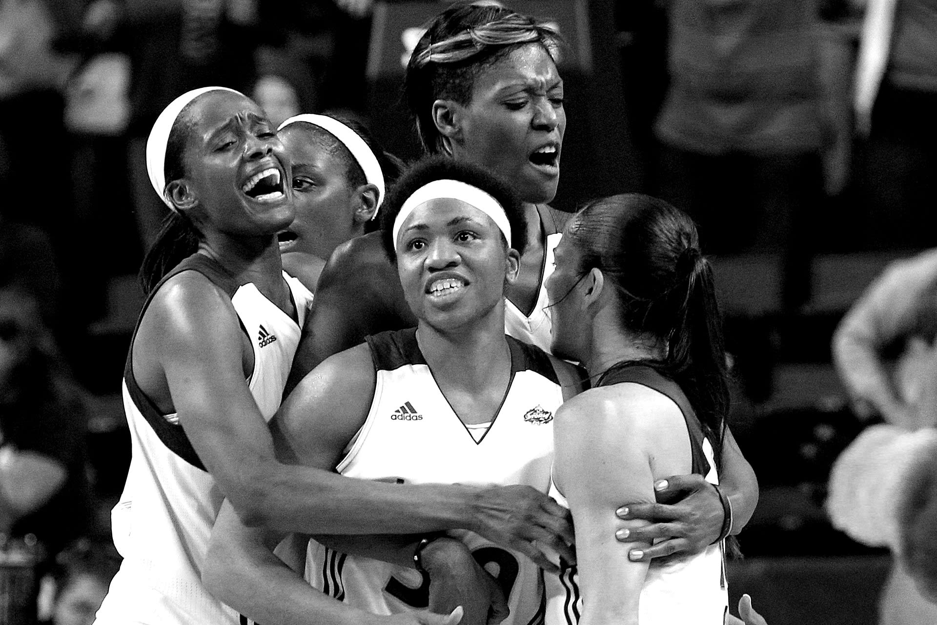 Seattle Storm's Sue Bird, right, is mobbed by teammates Swin Cash, left, Camille Little, Tanisha Wright, center front, and Ashley Robinson after Bird's game winning shot and the final buzzer against the Connecticut Sun in a WNBA basketball game Friday, Aug. 5, 2011, in Seattle. The Storm won 81-79, (AP Photo/Elaine Thompson)