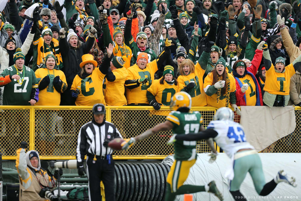 Green Bay Packers fans cheer as Packers wide receiver Davante Adams (17) scores a touchdown in front of Dallas Cowboys free safety Barry Church (42) during an NFL divisional playoff game at Lambeau Field on Sunday, January 11, 2015 in Green Bay, WI. The Packers beat the Cowboys 26-21. (AP Photo/Todd Rosenberg)