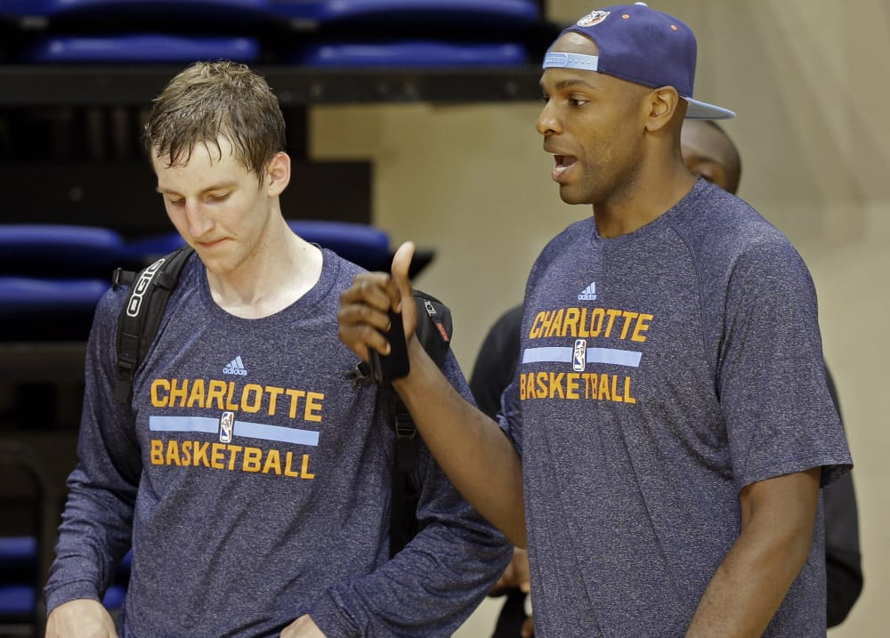 Charlotte Bobcats' Brandan Haywood, right, talks with Cody Zeller, left, after a practice at the NBA basketball team's training camp in Asheville, N.C., Wednesday, Oct. 2, 2013. (AP Photo/Chuck Burton)