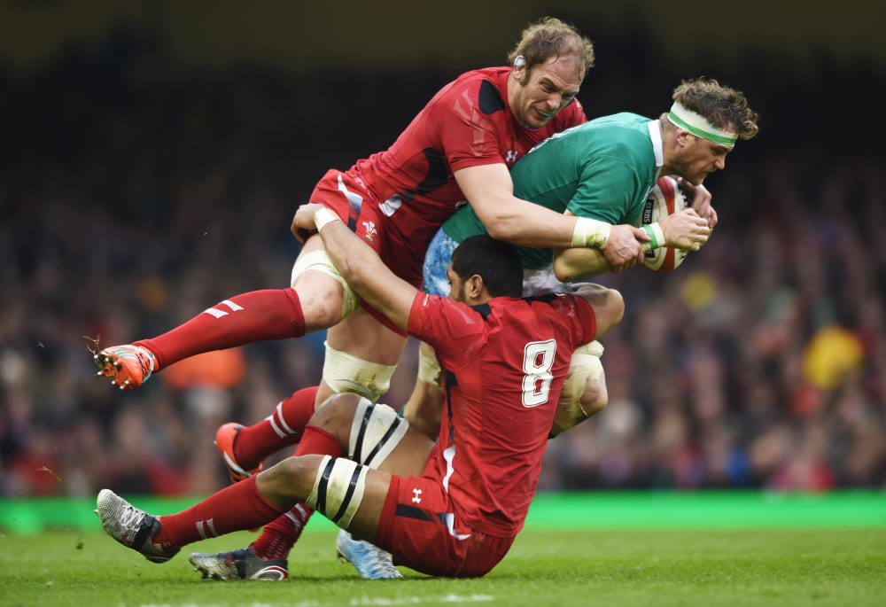Ireland's Jamie Heaslip is tackled by Taulupe Faletau and Alun Wyn Jones.  Wales v Ireland - RBS Six Nations, Britain - 14 Mar 2015  (Rex Features via AP Images)