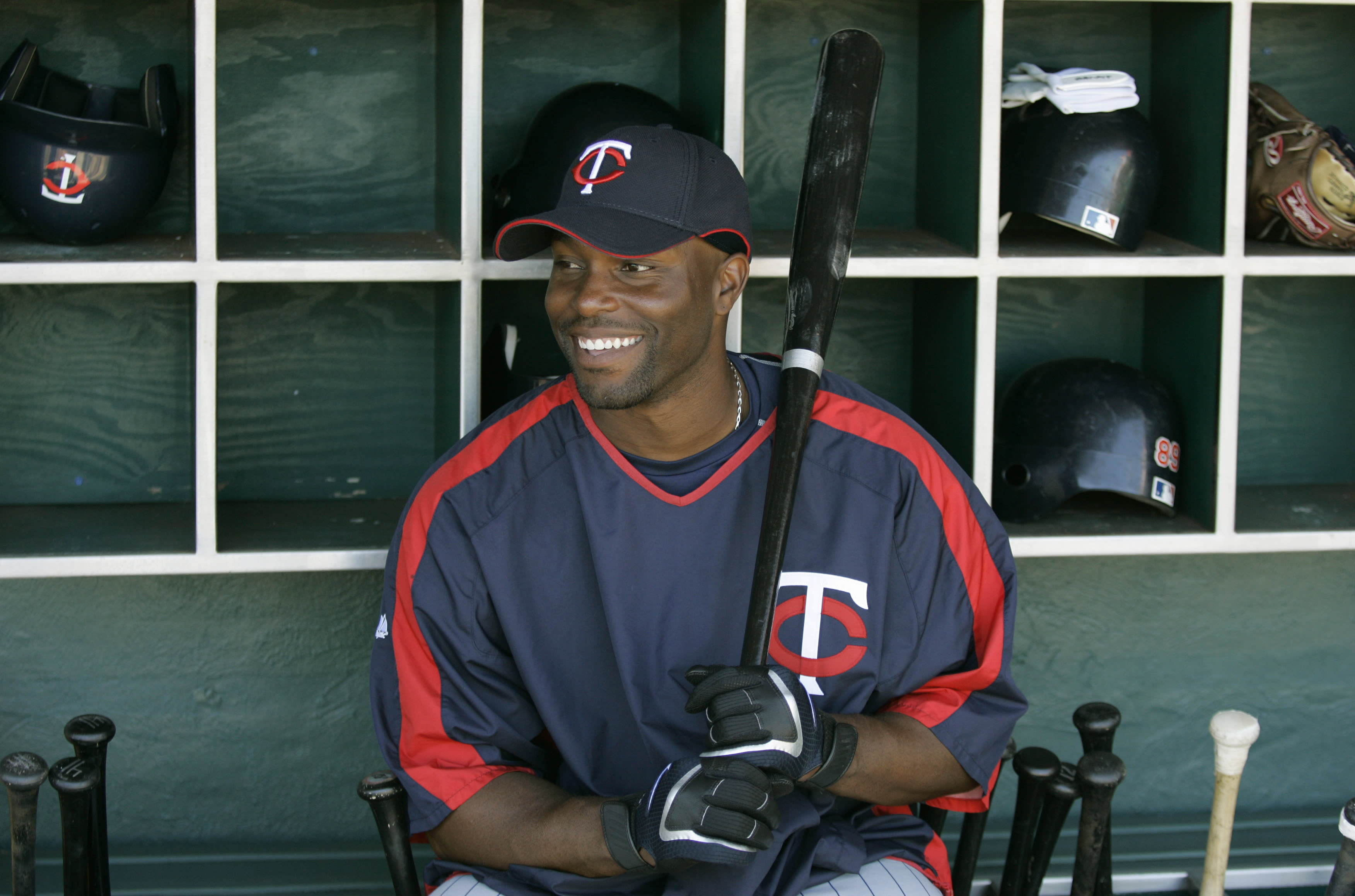 Minnesota Twins center fielder Torii Hunter poses for a photograph in the Twins dugout before the Twins faced the Philadelphia Phillies in their spring training baseball game in Clearwater, Fla., Sunday, March 25, 2007. (AP Photo/Kathy Willens)