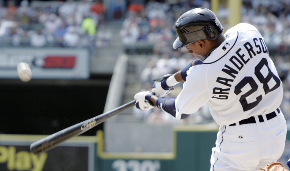 Detroit Tigers' Curtis Granderson hits a solo home run off of Texas Rangers' Jason Jennings in the first inning of a baseball game, Thursday, April 24, 2008, in Detroit. The Tigers beat the Rangers 8-2. (AP Photo/Duane Burleson)