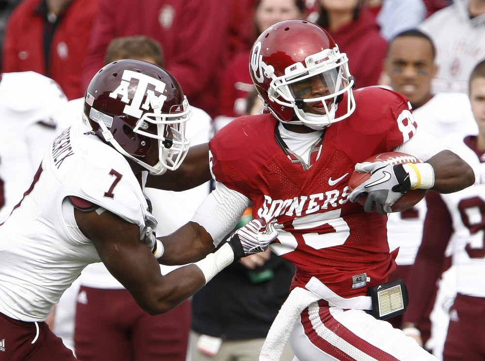 Oklahoma wide receiver Ryan Broyles (85) is tackled by Texas A&M defensive back Terrence Frederick (7) during the first half of a NCAA college football game in Norman, Okla. on Saturday, Nov. 5, 2011.  (AP Photo/Alonzo J. Adams)