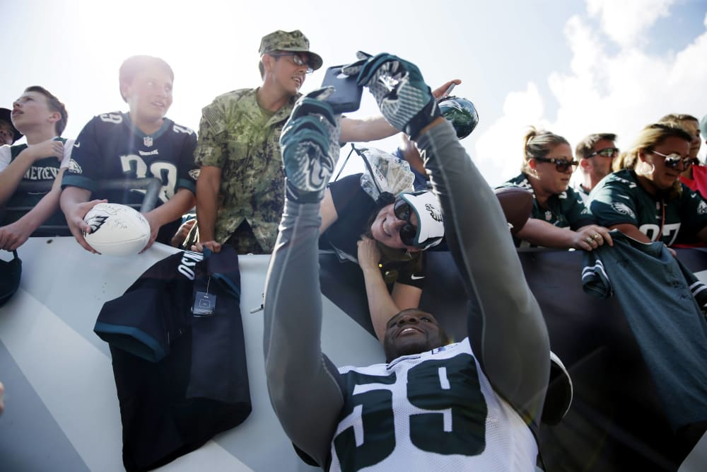 Philadelphia Eagles' DeMeco Ryans makes a selfie with a fan after practice at NFL football training camp, Tuesday, Aug. 4, 2015, in Philadelphia. (AP Photo/Matt Rourke)