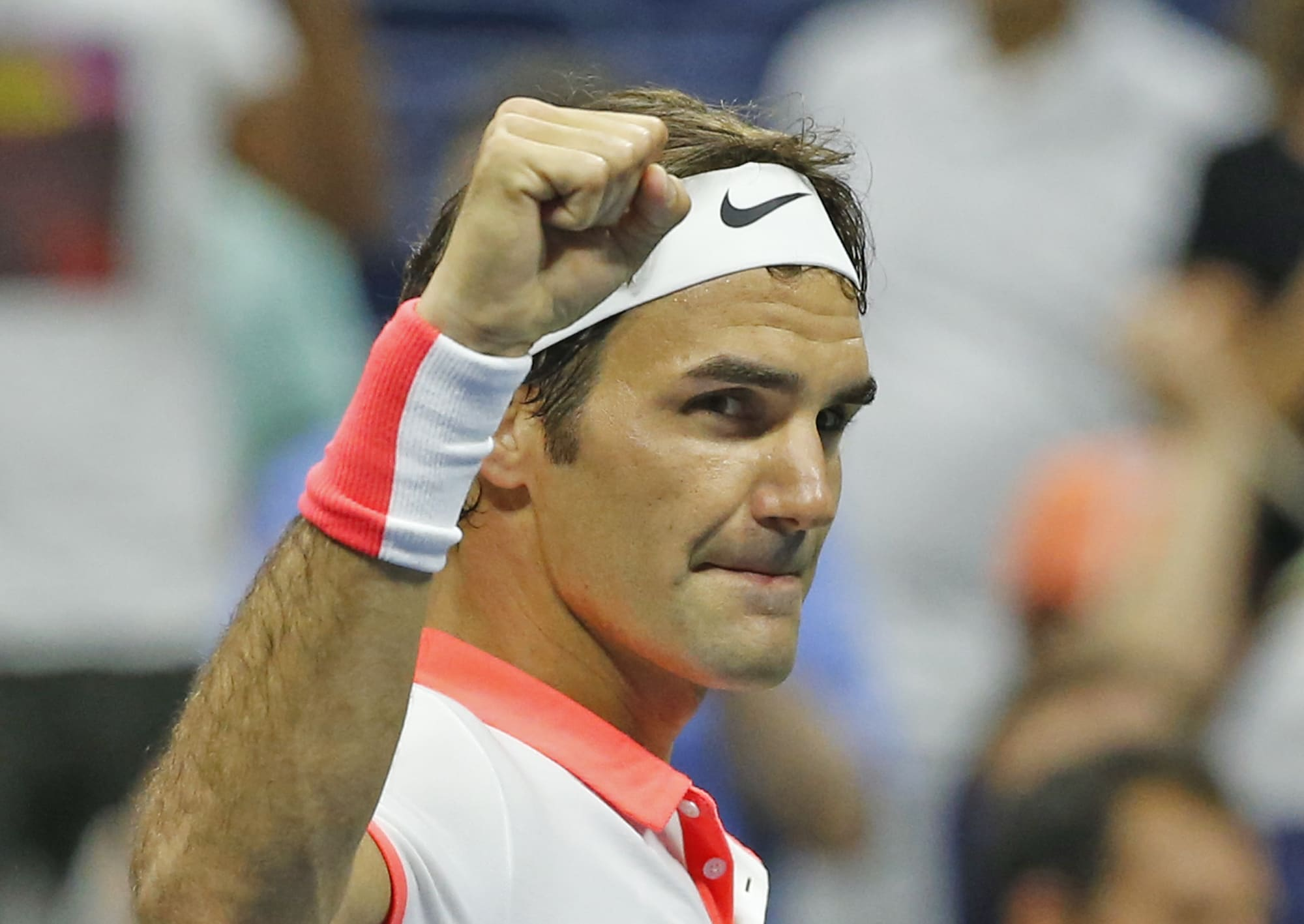 Roger Federer, of Switzerland, reacts after winning his fourth round match against John Isner, 7-6, 7-6, 7-5, at the U.S. Open tennis tournament in New York, Monday, Sept. 7, 2015. (AP Photo/Kathy Willens)
