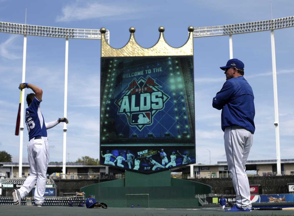 Kansas City Royals manager Ned Yost, right, watches as Eric Hosmer, left, warms up for baseball batting practice Wednesday, Oct. 7, 2015, in Kansas City, Mo. The Royals face the Astros in Game 1 of the ALDS Thursday in Kansas City. (AP Photo/Charlie Riedel)
