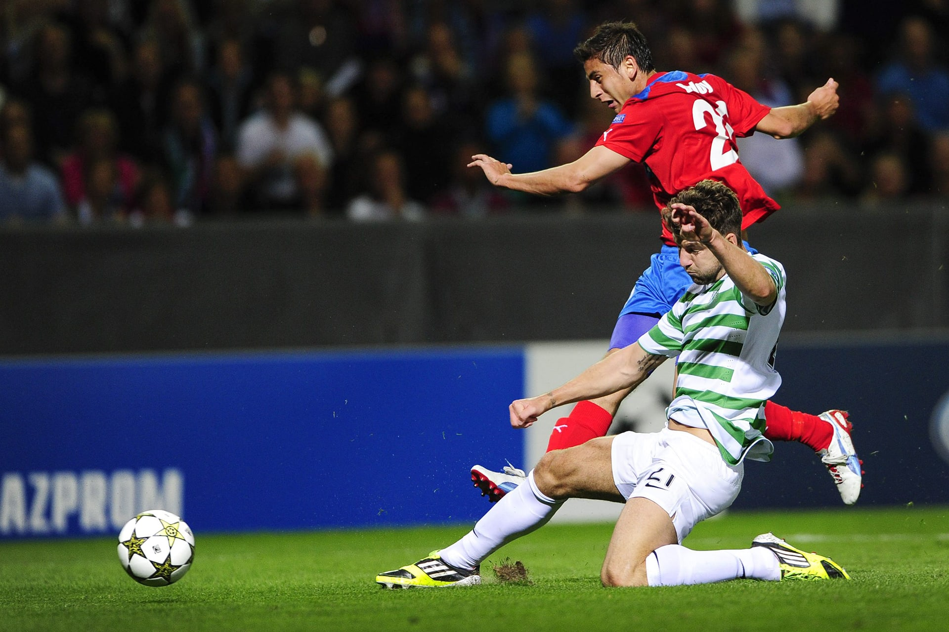 Alejandro Bedoya (top) of Helsingborg shoots past Celtic's Charlie Mulgrew (bottom) during the Champions League play-off soccer match between Helsingborgs IF and Celtic FC at the Olympia stadium in Helsingborg, Sweden, Tuesday, Aug. 21, 2012. (AP Photo/Scanpix Sweden/Bjorn Lindgren) SWEDEN OUT