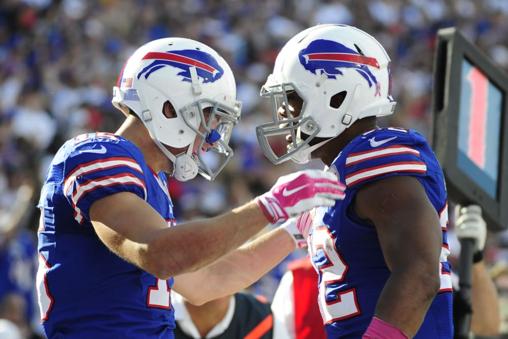 Buffalo Bills wide receiver Chris Hogan, left, celebrates a touchdown catch with Fred Jackson, right, during the second half of an NFL football game against the New England Patriots Sunday, Oct. 12, 2014, in Orchard Park, N.Y. (AP Photo/Gary Wiepert)