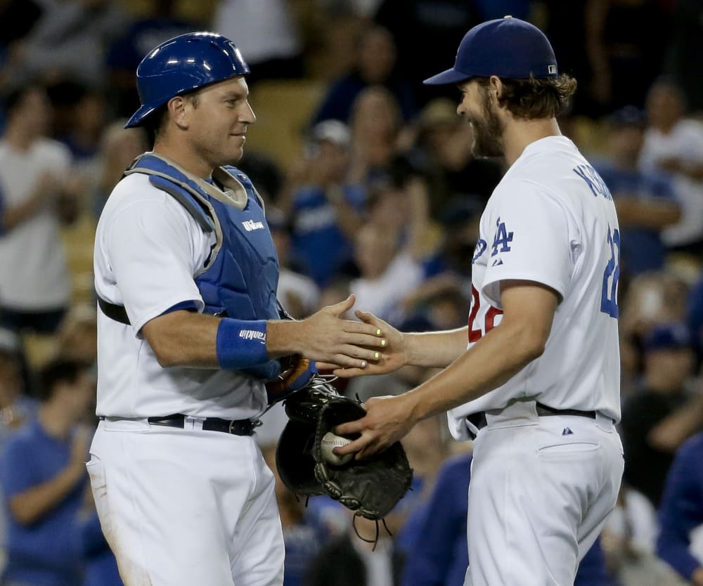 Los Angeles Dodgers Starting Pitcher Clayton Kershaw Right Celebrates With Catcher AJ Ellis After