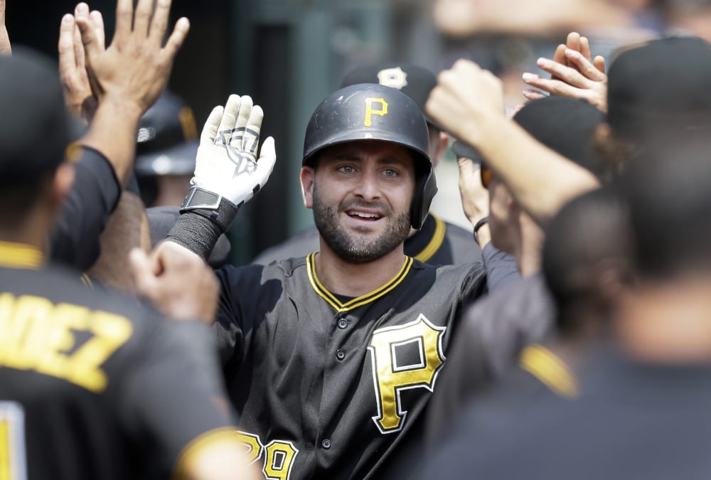 Pittsburgh Pirates' Francisco Cervelli is congratulated in the dugout after his solo home run off Detroit Tigers pitcher Kyle Ryan during the fourth inning of a baseball game, Thursday, July 2, 2015, in Detroit. (AP Photo/Carlos Osorio)