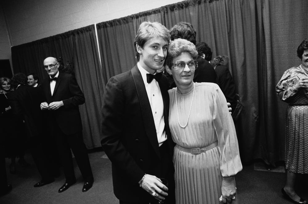 Edmonton Oilers' star Wayne Gretzky poses for a photo with his mother, Phyllis Gretzky before the start of the NHL All-Star banquet in Harford on Monday, Feb. 3, 1986. Gretzky was besieged by autograph seekers and people taking pictures. The NHL All-Star game is to be played Tuesday in Hartford, Conn. (AP Photo /Bob Child)