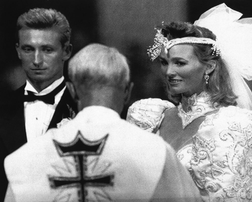 Canon John Munro of Brantford, Ontario gives the blessing to Wayne Gretzky and Janet Jones Gretzky in St. Joseph's Basilica, in Edmonton in afternoon on Saturday, July 16, 1988. Hollywood starlet Janet Jones and hockey superstar Wayne Gretzky were married in front of 700 friends and family. (AP Photo)