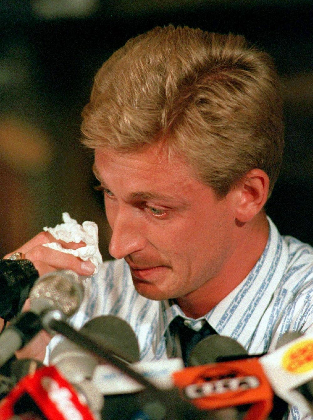 Wayne Gretzky wipes a tear during a news conference in Edmonton, Alta., announcing his trade from the Edmonton Oilers to the Los Angeles Kings August 9, 1988. (AP Photo/Ray Giguere)