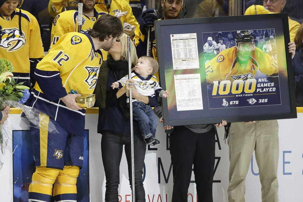 Mike Fisher, Carrie Underwood, Isaiah Fisher