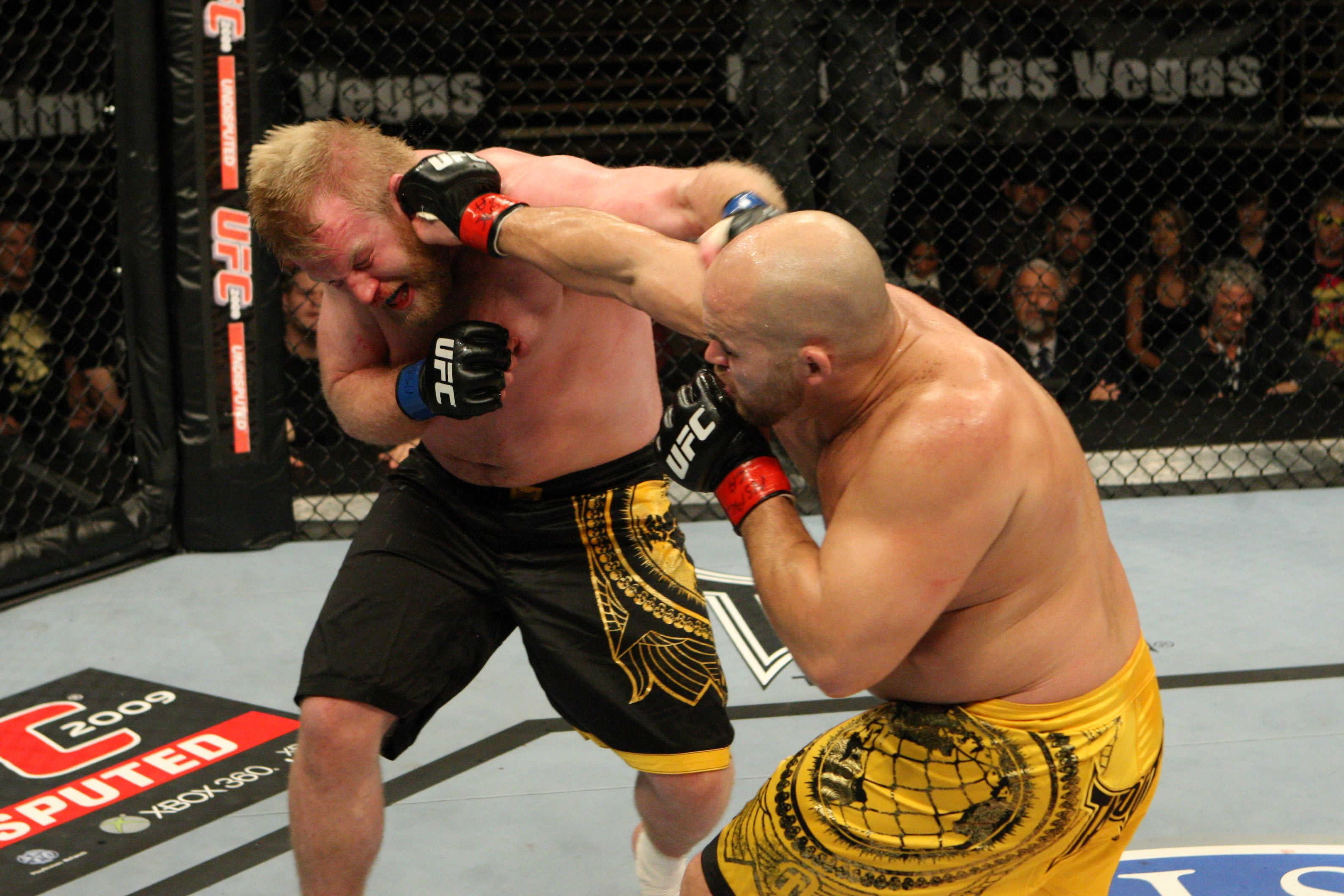 LAS VEGAS - DECEMBER 5: Jon Madsen (yellow shorts) def. Justin Wren (black shorts) - Split Decision during The Ultimate Fighter 10 Finale at The Pearl at the Palms on December 5, 2009 in Las Vegas, Nevada. (Photo by Josh Hedges/Zuffa LLC via Getty Images)