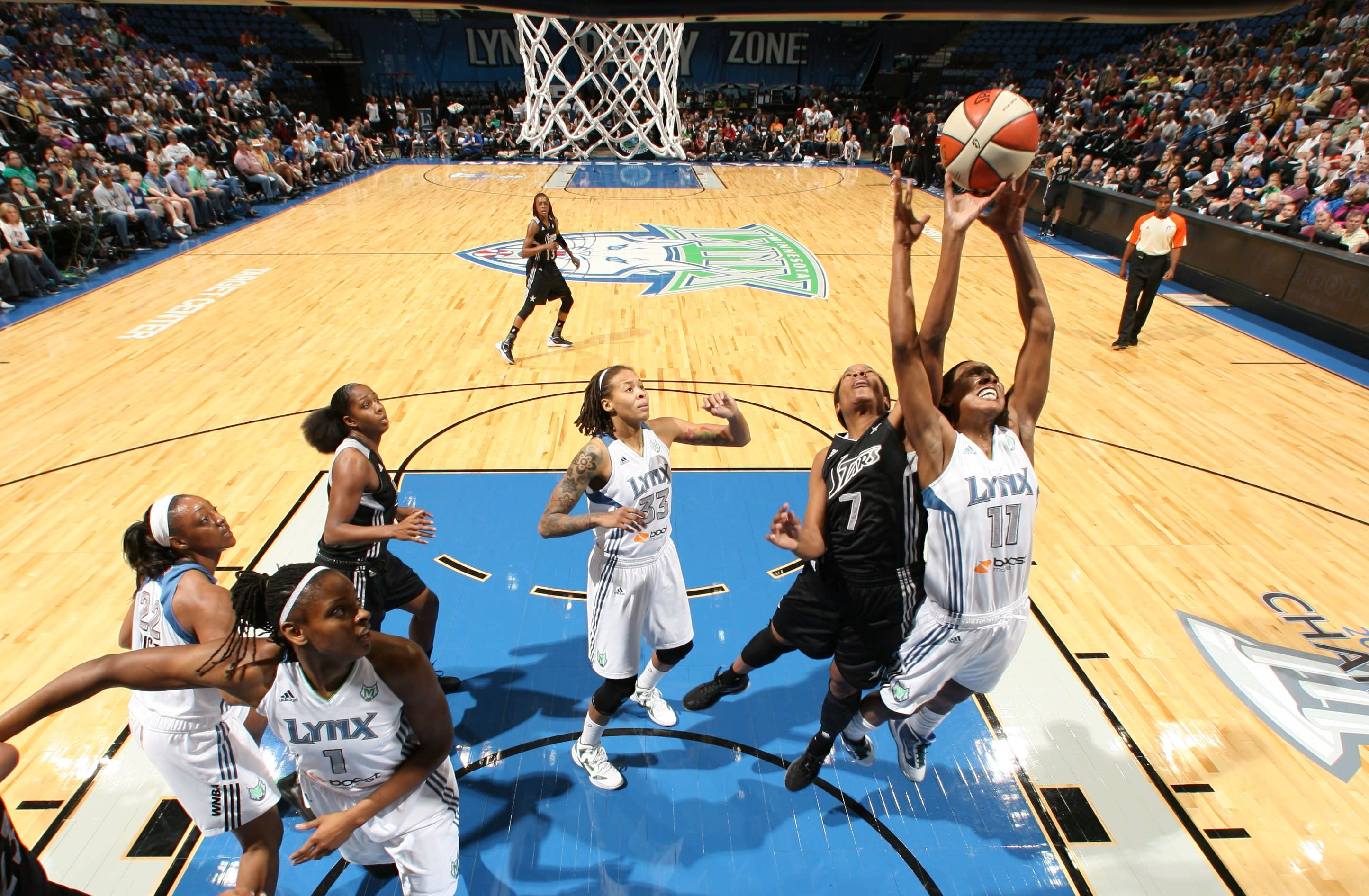 MINNEAPOLIS, MN - JUNE 03:  Candice Wiggins #11 of the Minnesota Lynx jumps for the rebound against Jia Perkins #7 of the San Antonio Silver Stars in the game on June 3, 2012 at Target Center in Minneapolis, Minnesota.  NOTE TO USER: User expressly acknowledges and agrees that, by downloading and or using this Photograph, user is consenting to the terms and conditions of the Getty Images License Agreement. Mandatory Copyright Notice: Copyright 2012 NBAE (Photo by David Sherman/NBAE via Getty Images)