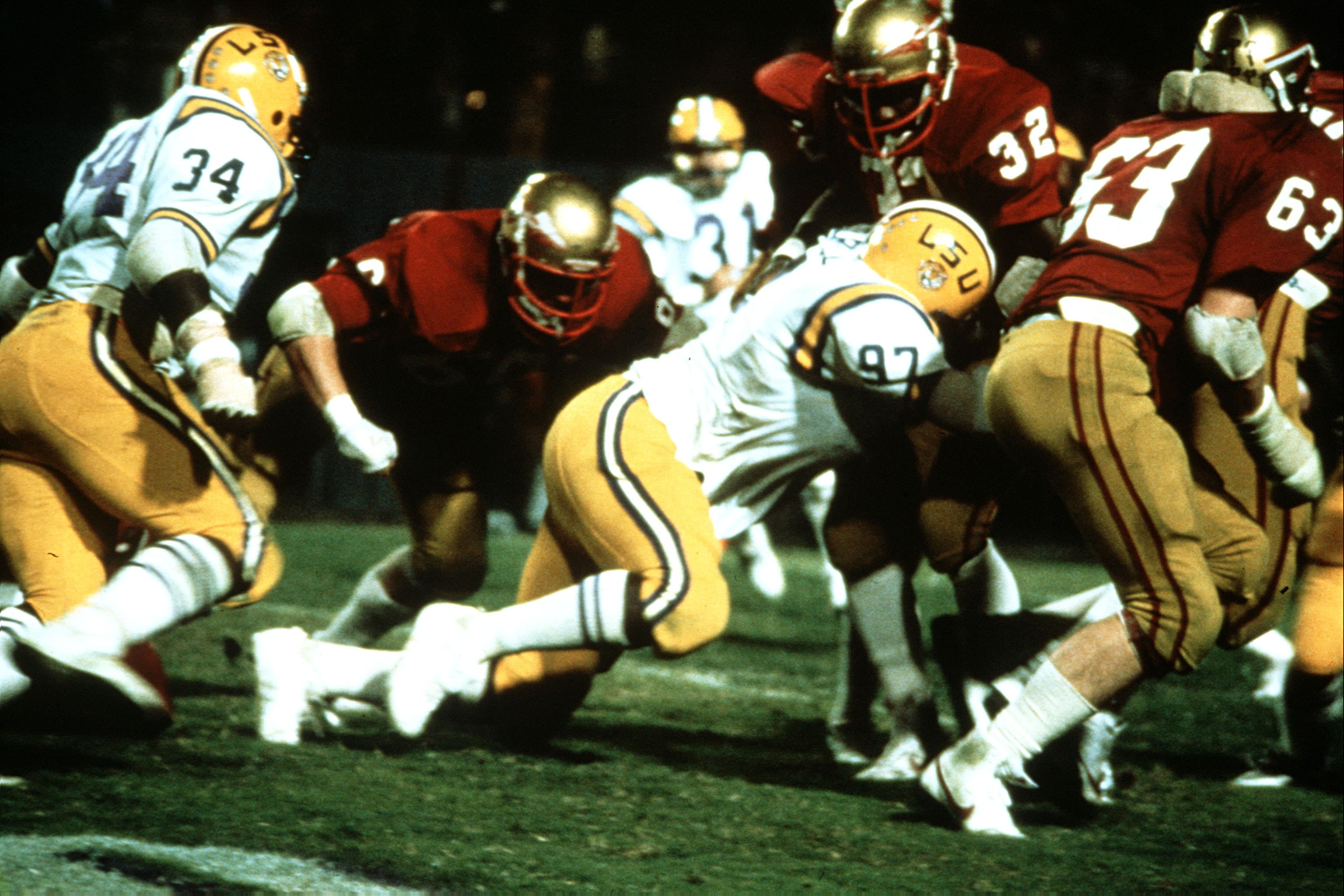 BATON ROUGE, LA - SEPTEMBER 18, 1982: Leonard Marshall #97 defensive end of the Louisiana State University Tigers tackles his opponent at Tiger Stadium in Baton Rouge, Louisiana. (Photo by Louisiana State University/Getty Images)