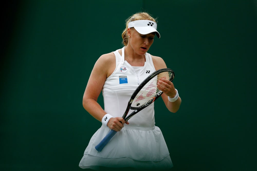 LONDON, ENGLAND - JUNE 26: Elena Baltacha of Great Britain reacts during her Ladies' Singles first round match against Karin Knapp of Italy on day two of the Wimbledon Lawn Tennis Championships at the All England Lawn Tennis and Croquet Club on June 26, 2012 in London, England. (Photo by Paul Gilham/Getty Images)