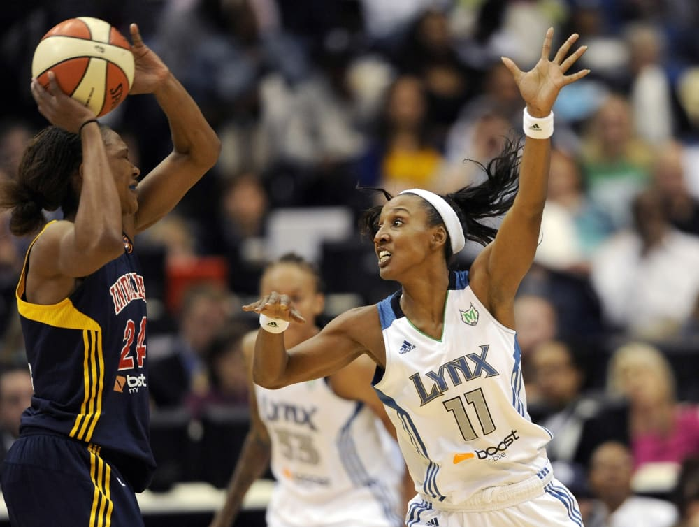 MINNEAPOLIS, MN - OCTOBER 14: Candice Wiggins #11 of the Minnesota Lynx guards against Tamika Catchings #24 of the Indiana Fever during the first quarter in Game One of the 2012 WNBA Finals on October 14, 2012 at Target Center in Minneapolis, Minnesota. NOTE TO USER: User expressly acknowledges and agrees that, by downloading and or using this Photograph, user is consenting to the terms and conditions of the Getty Images License Agreement. (Photo by Hannah Foslien/Getty Images)