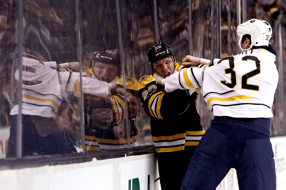 BOSTON, MA - JANUARY 31: John Scott #32 of the Buffalo Sabres punches Shawn Thornton #22 of the Boston Bruins during a game at the TD Garden on January 31, 2013 in Boston, Massachusetts. (Photo by Alex Trautwig/Getty Images)