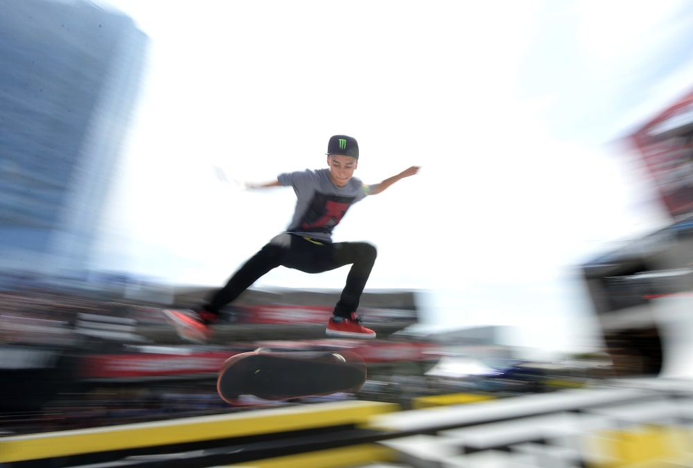 LOS ANGELES, CA - AUGUST 02:  Nyjah Huston attempts a rail slide before the Street League Skateboarding Preliminary during X Games Los Angeles at the Event Deck at L.A. Live on August 2, 2013 in Los Angeles, California.  (Photo by Harry How/Getty Images)