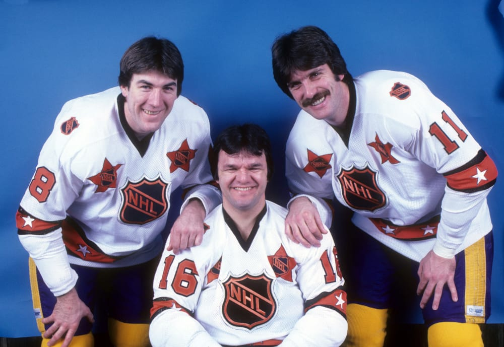 HARTFORD, CT - JANUARY 14: Dave Taylor #18, Marcel Dionne #16 and Charlie Simmer #11 of the Wales Conference and Los Angeles Kings pose for a portrait before their game against the Hartford Whalers as they were selected for the 1981 33rd NHL All-Star Game on January 14, 1981 at the Hartford Civic Center in Hartford, Connecticut. (Photo by B Bennett/Getty Images)