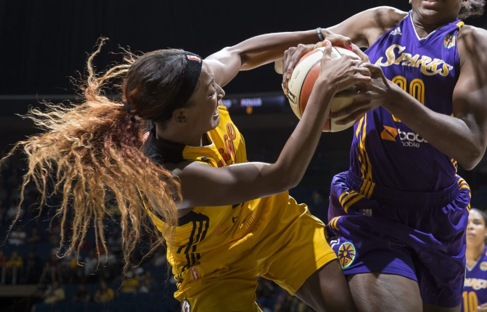 TULSA, OK - SEPTEMBER 6: Candice Wiggins #2 of the Tulsa Shock forces a jump ball against Nneka Ogwumike #30 of the Los Angeles Sparks during the WNBA game on September 6, 2013 at the BOK Center in Tulsa, Oklahoma.  NOTE TO USER: User expressly acknowledges and agrees that, by downloading and or using this photograph, User is consenting to the terms and conditions of the Getty Images License Agreement. Mandatory Copyright Notice: Copyright 2013 NBAE (Photo by Shane Bevel/NBAE via Getty Images)