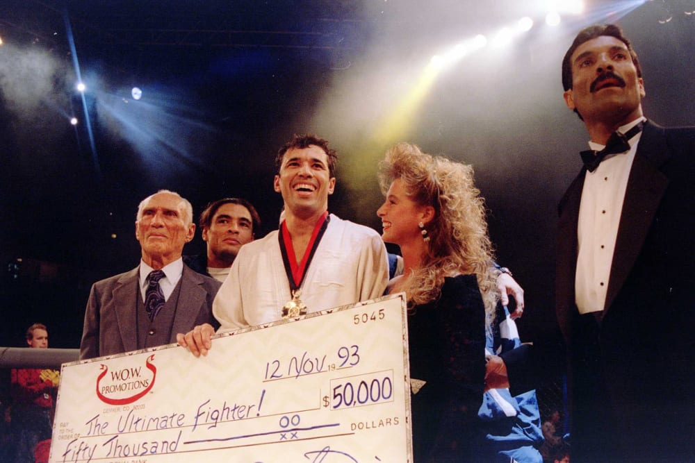 """Jiu-Jitsu black belt Royce Gracie (USA) receives a $50,000 check after becoming """"The Ultimate Fighter"""" by defeating Gerard Gordeau of the Netherlands int he finals of the Ultimate Fighter Championships in Denver, Colorado.  Mandatory Credit: Markus Boesch"""