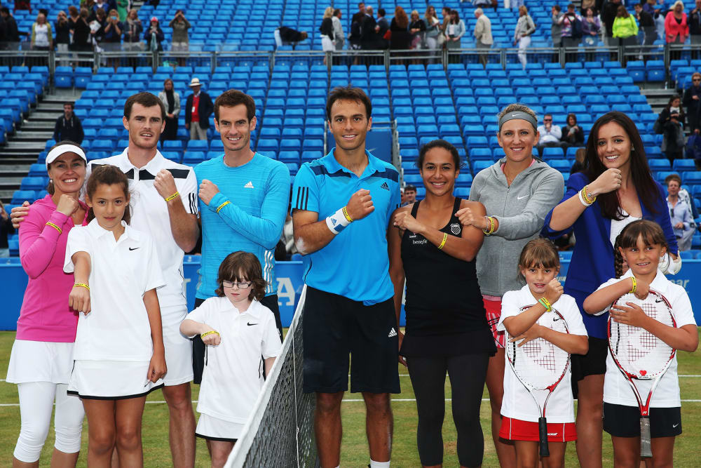 LONDON, ENGLAND - JUNE 15: (L-R) Martina Hingis, Jamie Murray, Andy Murray, Ross Hutchins, Heather Watson, Ross Hutchins, Victoria Azarenka and Laura Robson show their 'Rally for Bally' wristbands at a charity event on day seven of the Aegon Championships at Queens Club on June 15, 2014 in London, England. The 'Rally for Bally' is a fundraising effort in memory of the former British tennis player Elena Baltacha who died recently of liver cancer. (Photo by Matthew Stockman/Getty Images)