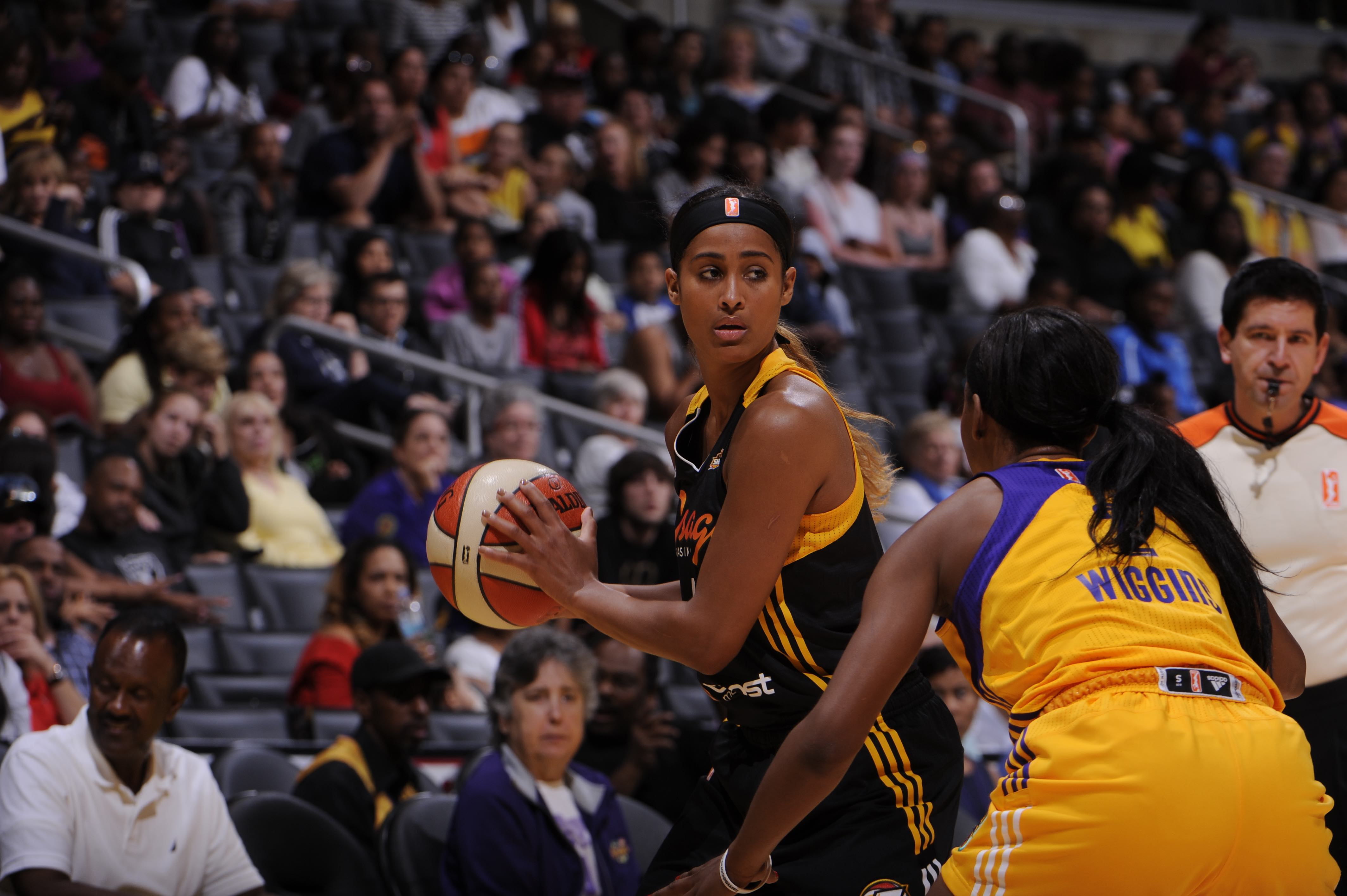 LOS ANGELES, CA - AUGUST 5: Skylar Diggins #4 of the Tulsa Shock handles the ball against Candice Wiggins #2 of the Los Angeles Sparks at STAPLES Center on August 5 2014 in Los Angeles, California. NOTE TO USER: User expressly acknowledges and agrees that, by downloading and or using this photograph, User is consenting to the terms and conditions of the Getty Images License Agreement. Mandatory Copyright Notice: Copyright 2014 NBAE (Photo by Juan Ocampo/NBAE via Getty Images)