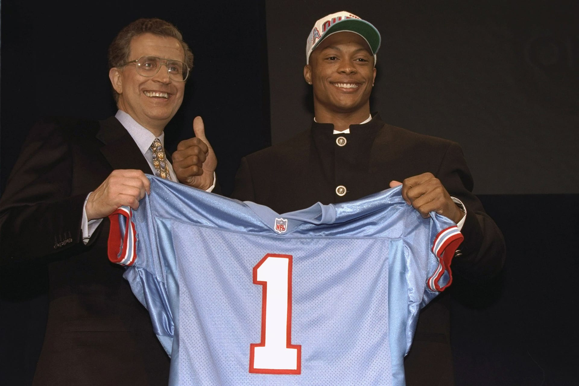 Football: NFL Draft: Closeup of Houston Oilers running back and No 14 overall pick Eddie George victorious on stage with NFL commissioner Paul Tagliabue during selection process at Madison Square Garden.  New York, NY 4/20/1996 CREDIT: Manny Millan (Photo by Manny Millan /Sports Illustrated/Getty Images) (Set Number: X50613 )