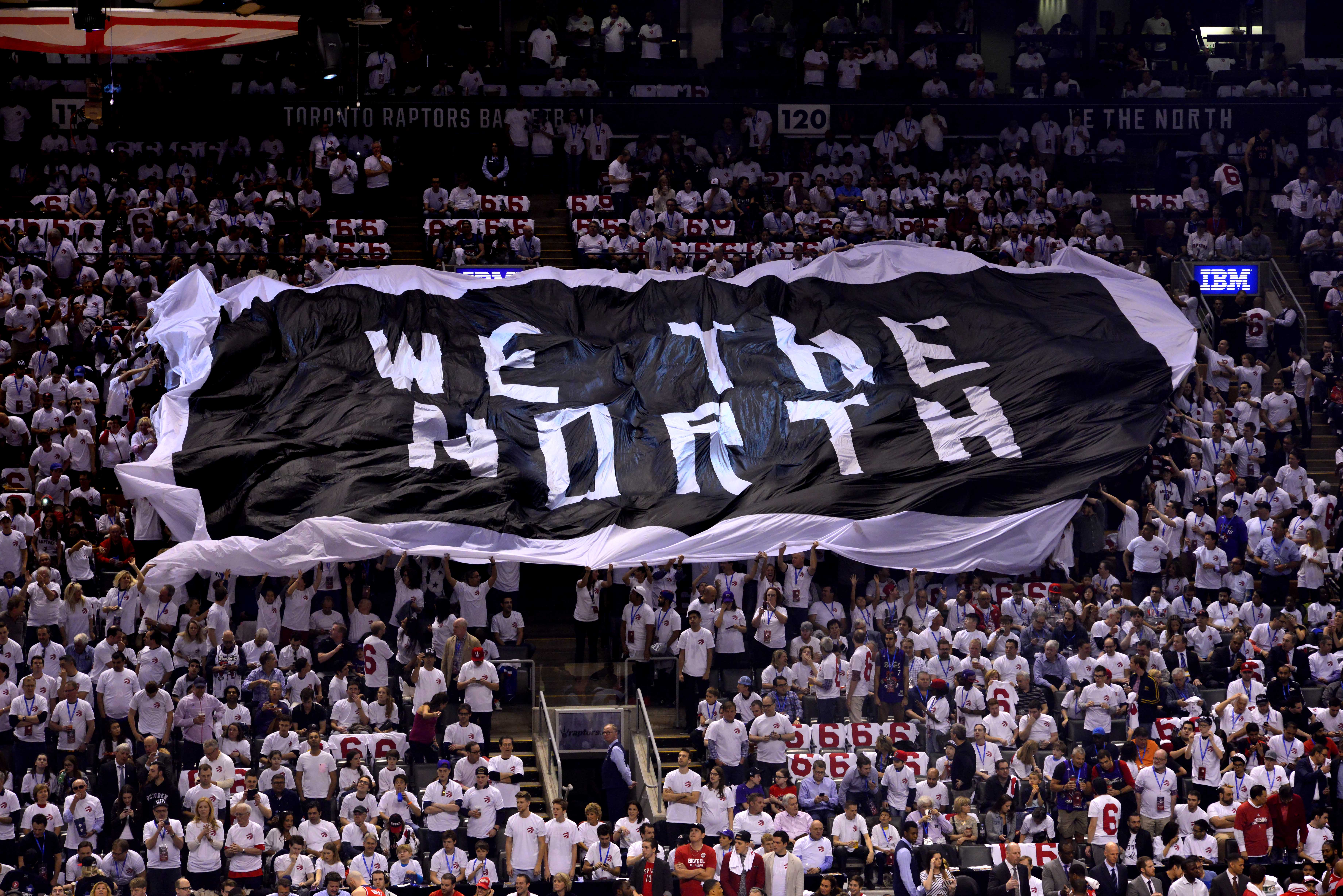"""TORONTO, CA - APRIL 18: An overall view of the Air Canada Centre while the fans pass around the """"WE ARE THE NORTH"""" flag during Game One of the Eastern Conference Playoffs Washington Wizards against the Toronto Raptors on April 18, 2015 in Toronto, Canada. NOTE TO USER: User expressly acknowledges and agrees that, by downloading and or using this photograph, User is consenting to the terms and conditions of the Getty Images License Agreement. Mandatory Copyright Notice: Copyright 2015 NBAE (Photo by David Dow/NBAE via Getty Images)"""