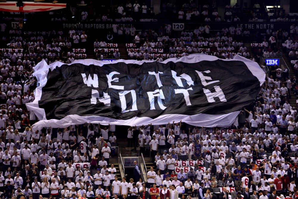 "TORONTO, CA - APRIL 18: An overall view of the Air Canada Centre while the fans pass around the ""WE ARE THE NORTH"" flag during Game One of the Eastern Conference Playoffs Washington Wizards against the Toronto Raptors on April 18, 2015 in Toronto, Canada. NOTE TO USER: User expressly acknowledges and agrees that, by downloading and or using this photograph, User is consenting to the terms and conditions of the Getty Images License Agreement. Mandatory Copyright Notice: Copyright 2015 NBAE (Photo by David Dow/NBAE via Getty Images)"