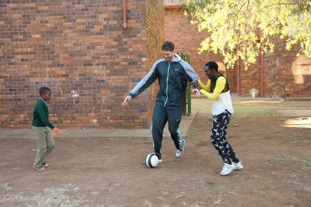 ENNERDALE, SA - JULY 31: Pau Gasol #16 of the Chicago Bulls plays soccer with the children during the NBA Cares Court Dedication as part of the Basketball Without Boarders program on July 31, 2015 at the SOS Children's Village in Ennerdale, South Africa. NOTE TO USER: User expressly acknowledges and agrees that, by downloading and or using this photograph, User is consenting to the terms and conditions of the Getty Images License Agreement. Mandatory Copyright Notice: Copyright 2015 NBAE (Photo by Joe Murphy/NBAE via Getty Images)