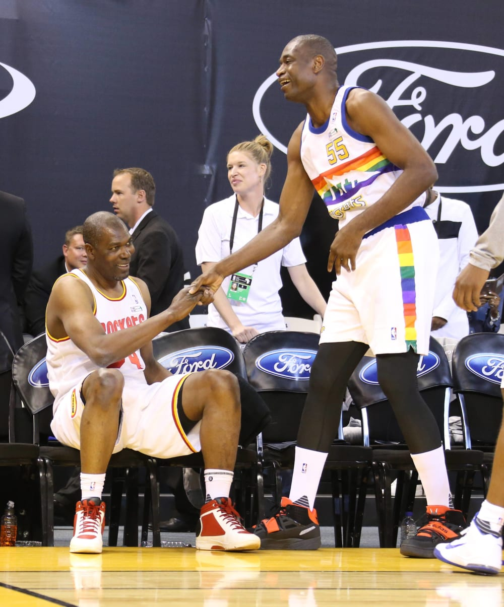 JOHANNESBURG, SA - AUGUST 1: NBA Legends Hakeem Olajuwon and Dikembe Mutombo high-five as they guest play for Team Africa during the NBA Africa Game 2015 as part of Basketball Without Borders on August 1, 2015 at the Ellis Park Arena in Johannesburg, South Africa. NOTE TO USER: User expressly acknowledges and agrees that, by downloading and or using this photograph, User is consenting to the terms and conditions of the Getty Images License Agreement. Mandatory Copyright Notice: Copyright 2015 NBAE (Photo by Nathaniel S. Butler/NBAE via Getty Images)