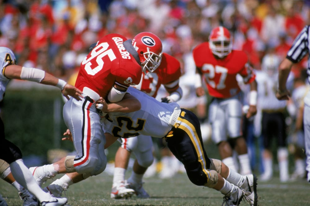 UNDATED - Nose guard Bill Goldberg Jr. of the University of Georgia Bulldogs makes a block during a game circa the 1988-1991 season. (Photo by Allen Steele/Getty Images)