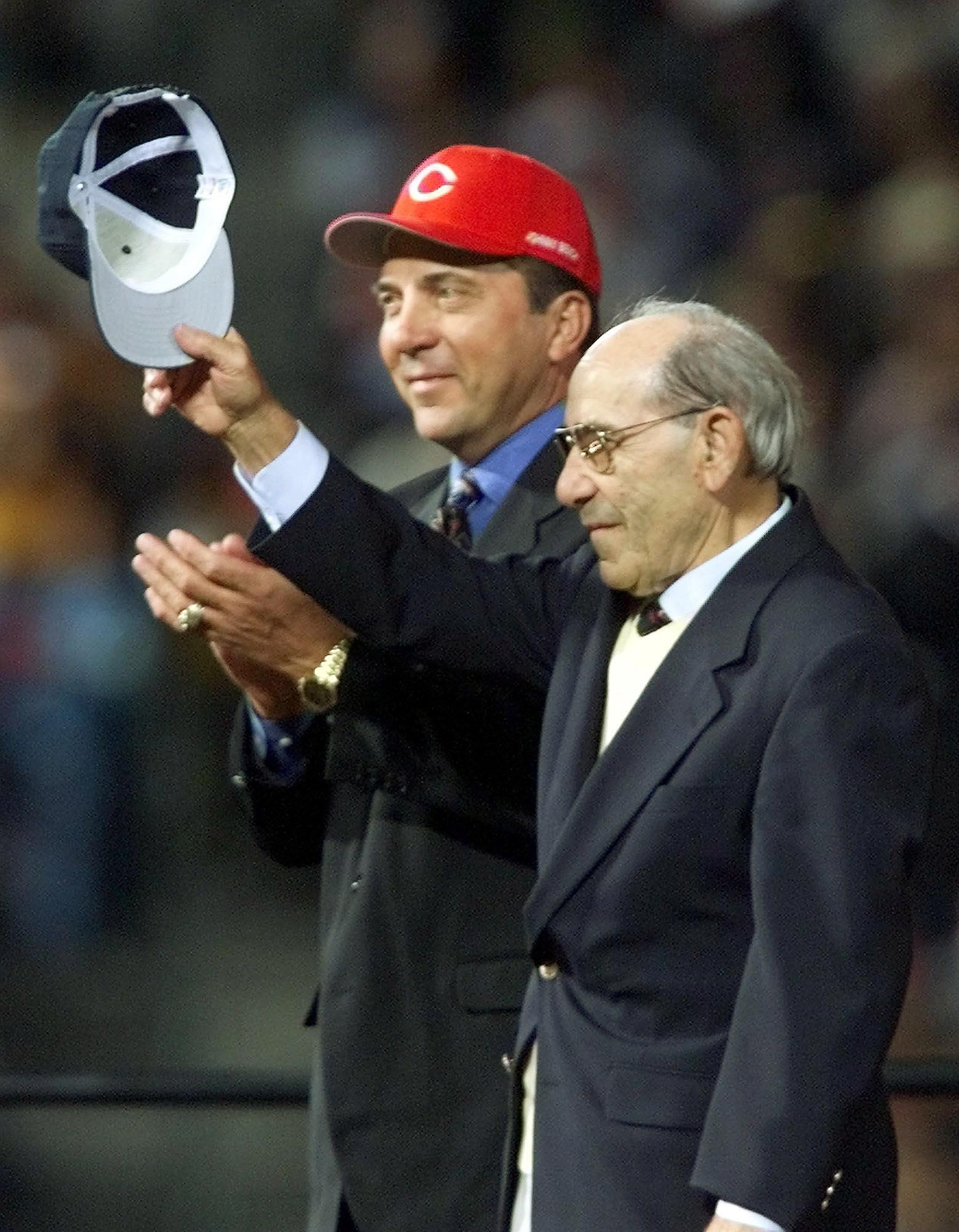 ATLANTA, UNITED STATES:  All-Century team members, catchers Yogi Berra (R) and Johnny Bench, are introduced 24 October, 1999 before game two of the 1999 World Series at Turner Field in Atlanta, GA. Berra played for the New York Yankees and Bench for the Cincinnati Reds. The New York Yankees have a 1-0 lead over the Atlanta Braves in the best-of-seven series.   (ELECTRONIC IMAGE)  AFP PHOTO/JEFF HAYNES (Photo credit should read JEFF HAYNES/AFP/Getty Images)