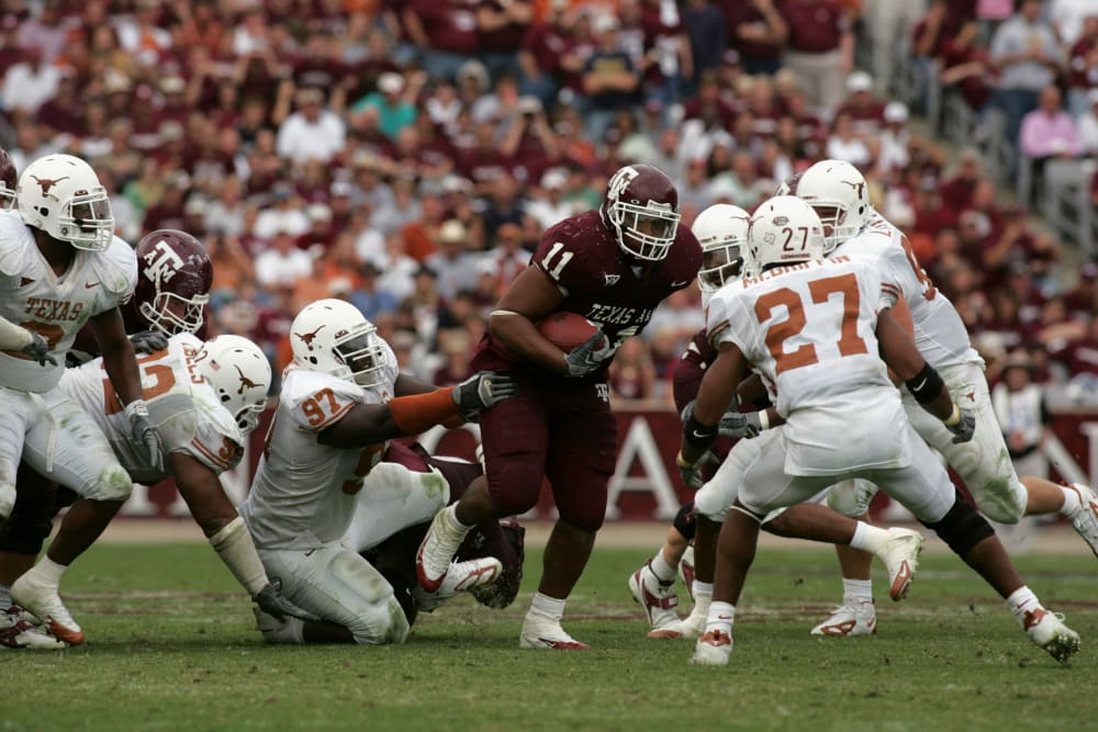 COLLEGE STATION, TX - NOVEMBER 25:  Running back Jorvorskie Lane #11 of the Texas A&M Aggies carries the ball against the Texas Longhorns at Kyle Field on November 25, 2005  in College Station, Texas.  The Longhorns defeated the Aggies 40-29.  (Photo by Ronald Martinez/Getty Images)