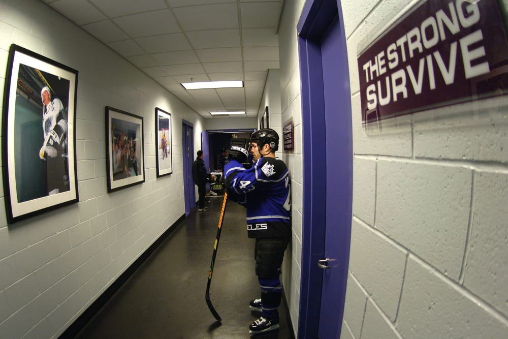 LOS ANGELES - DECEMBER 17: Mike Weaver #43 of the Los Angeles Kings waits for teammates in the hallway prior to their NHL game against the Phoenix Coyotes on December 17, 2005 at the Staples Center in Los Angeles, California. (Photo by Juan Ocampo/Getty Images)