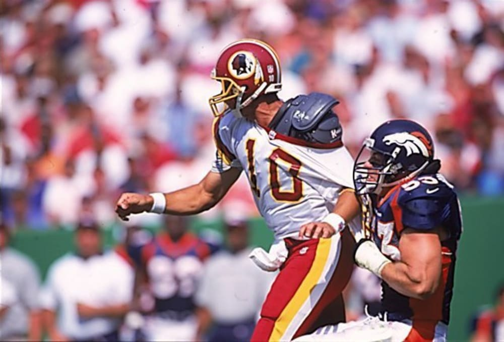 UNITED STATES - SEPTEMBER 27:  Football: Washington Redskins QB Trent Green (10) in action during tackle vs Denver Broncos Bill Romanowski (53), Landover, MD 9/27/1998  (Photo by Damian Strohmeyer/Sports Illustrated/Getty Images)  (SetNumber: X56466)