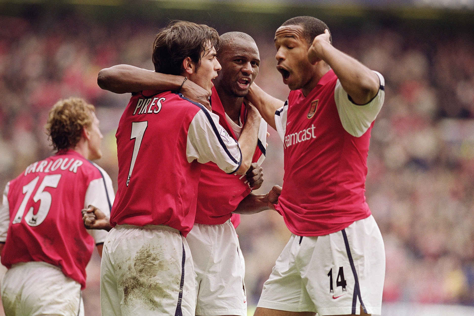 8 Apr 2001: Patrick Vieira (centre) celebrates scoring the equalising goal with team-mates Robert Pires (left) and Thierry Henry (right) all of Arsenal during the AXA sponsored FA Cup Semi-Final match against Tottenham Hotspur played at Old Trafford, inManchester, England. Arsenal won the match 2-1. Mandatory Credit: Ross Kinnaird /Allsport