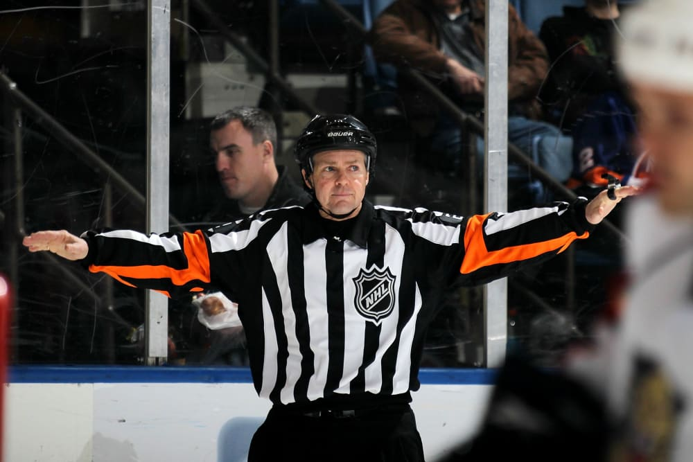 UNIONDALE, NY - JANUARY 21: Referee Kerry Fraser works the game between the Florida Panthers and the New York Islanders at the Nassau Coliseum on January 21, 2010 in Uniondale, New York. (Photo by Bruce Bennett