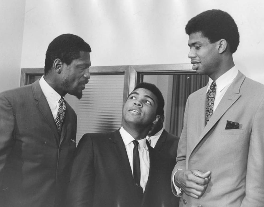 At a meeting of the Negro Industrial and Economic Union organized by football great Jim Brown, a group of top African American athletes from different sporting disciplines gathered to give support and hear the boxer Muhammad Ali give his reasons for rejecting the draft during the Vietnam War, Cleveland, June 4, 1967. Left to right, basketball player Bill Russell, boxing champ Muhammad Ali, and basketball player Kareem Abdul Jabbar. (Photo by Robert Abbott Sengstacke/Getty Images)