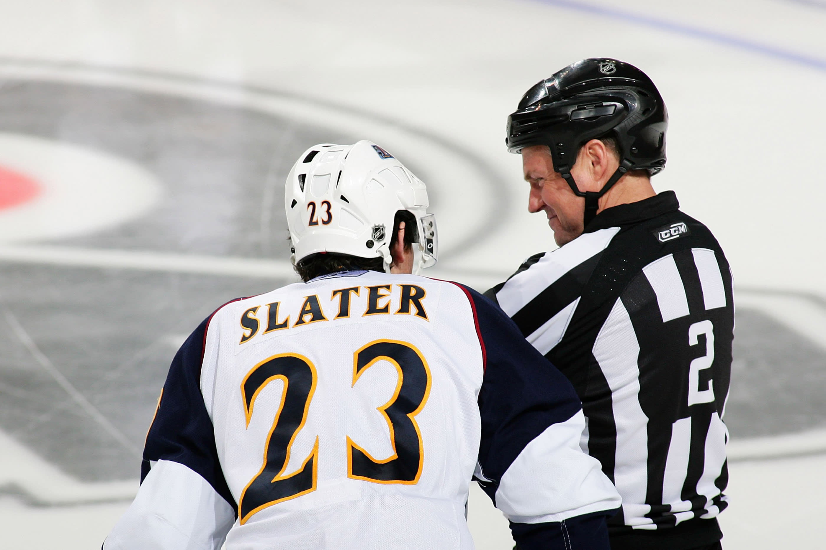 PHILADELPHIA - MARCH 21: Referee Kerry Fraser #2 exchanges a few words with Jim Slater #23 of the Atlanta Thrashers during a game against the Philadelphia Flyers on March 21, 2010 at the Wachovia Center in Philadelphia, Pennsylvania. (Photo by Len Redkoles/NHLI via Getty Images)