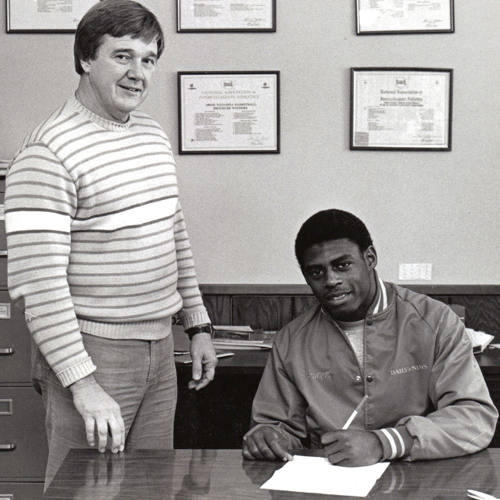 Signing-my-letter-of-intent-At-Carson-Newman-with-Coach-Dennis-Webb