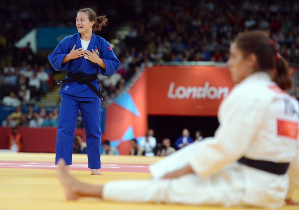 Jul 30, 2012; London, United Kingdom; Marti Malloy (USA), left, celebrates after defeating Giulia Quintavalle (ITA) in the women's 57 kg judo bronze medal contest during the London 2012 Olympic Games at ExCeL - South Arena 3. Mandatory Credit: Matt Kryger-USA TODAY Sports